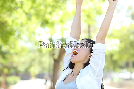 excited woman celebrating success in a