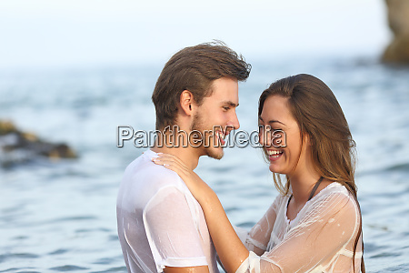 happy couple laughing bathing on the