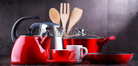 composition with kitchen vessels kettles and