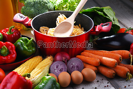 fresh vegetables and cooking pot on