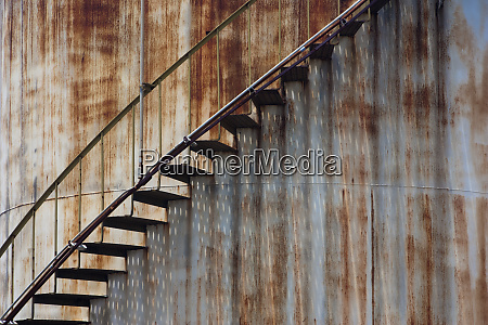 staircase on a rusting iron structure