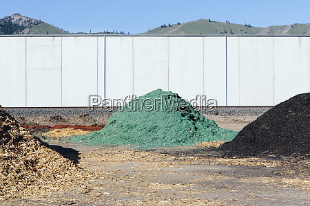 piles of green bark wood chips