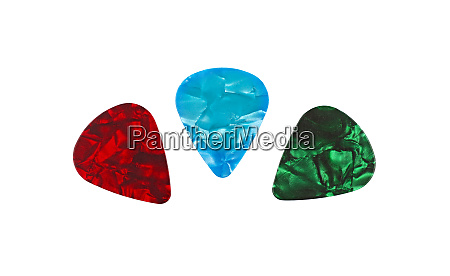 three colorful guitar picks isolated on