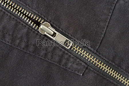 open crosswise brass zip on black