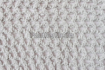 white knitting pattern or knitted pattern