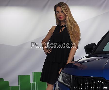 stand girl at salone auto torino