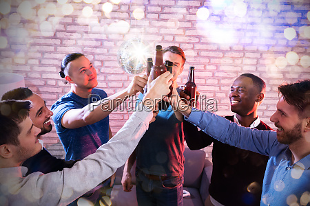 group of multiracial friend raising toast