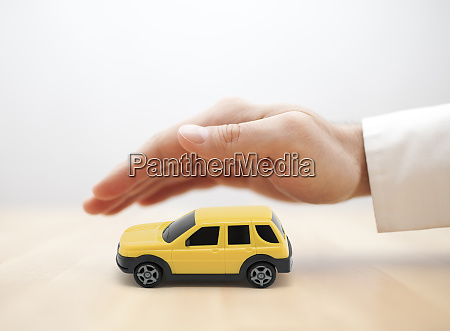car insurance concept with yellow car