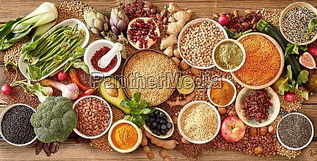 bowls of assorted cereals legumes and