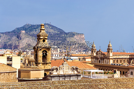 cityscape with churches in palermo italy