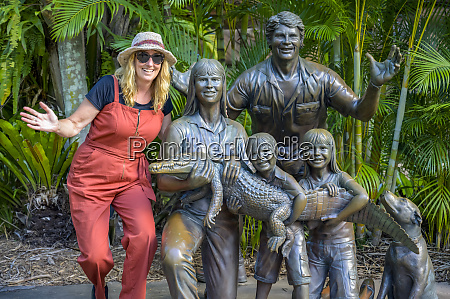 tourist with statue of irwin family