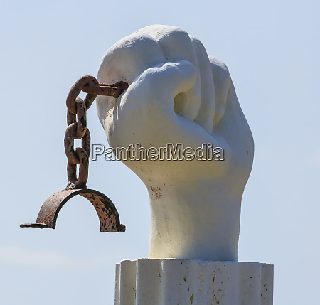 hand and chain sculpture symbolizing the