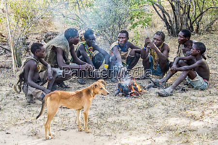 hadzabe hunters and their dog gather