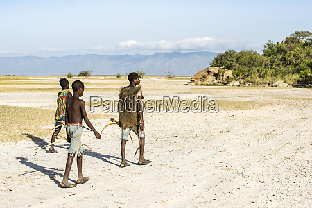 hadzabe hunters returning to camp after
