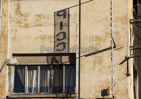 shadow of an advertisement on a