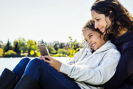 a mom and her daughter taking