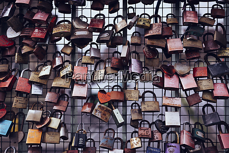 love lock padlocks on fence reeperbahn
