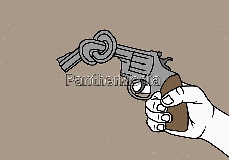man holding knotted gun