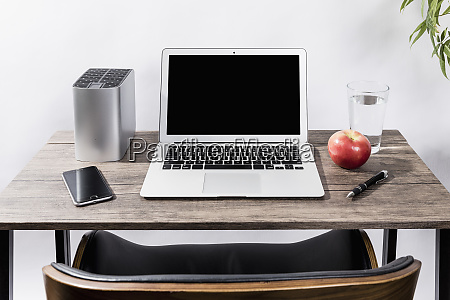 laptop smart phone apple water and