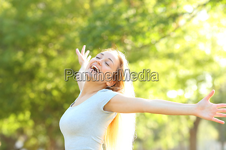 happy teenage girl stretching arms in
