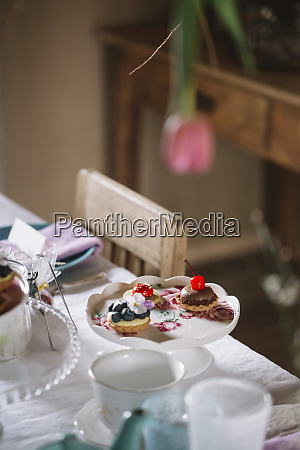 cake stand with pastries on laid