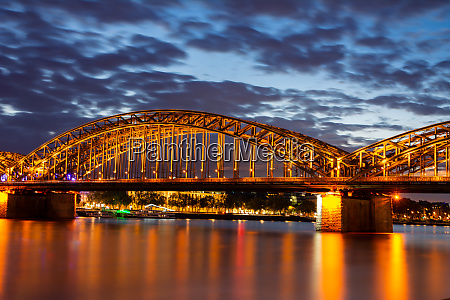 illuminated hohenzollern bridge in cologne