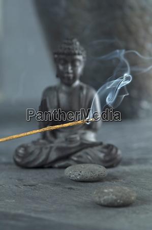 joss stick and buddha figurine