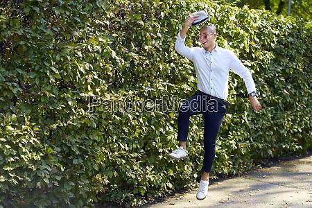 happy young man jumping around at