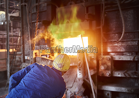 industry smeltery worker checking blast furnace