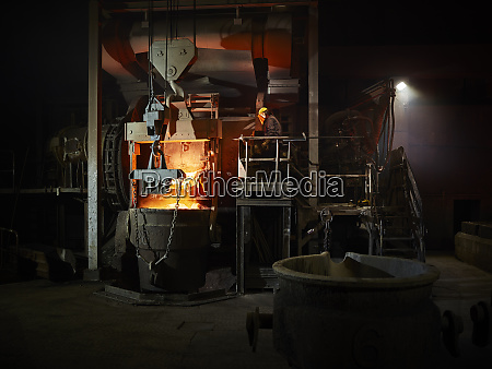 industry worker controlling smelting process