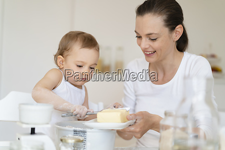 mother and little daughter making a