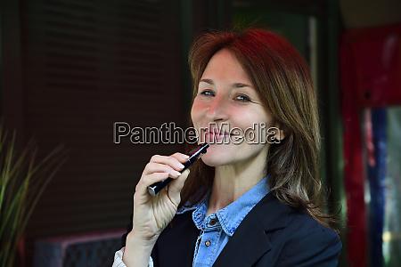 portrait of a mature woman smoking