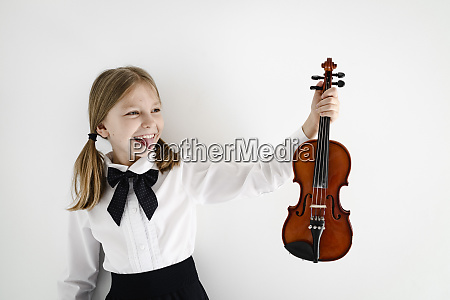 funny girl holding a violin