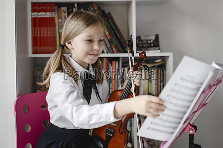 smiling girl with violin looking at