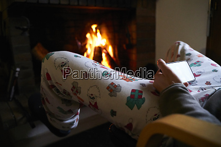 man sitting in front of fireplace