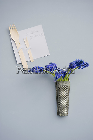 invitation decorated with wooden cutlery grater