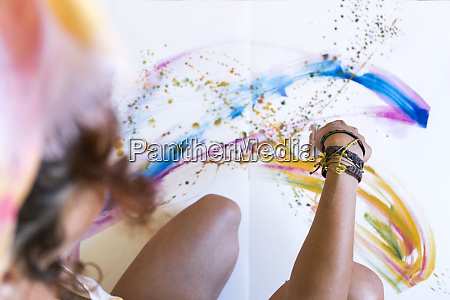 close up of woman painting on