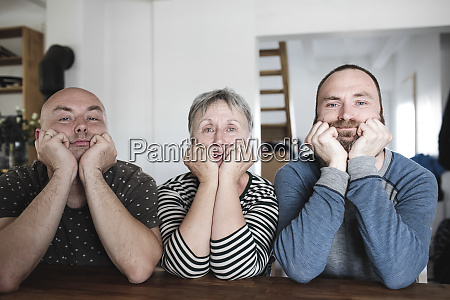 portrait of adult sons with senior