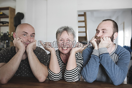 portrait of adult sons with laughing