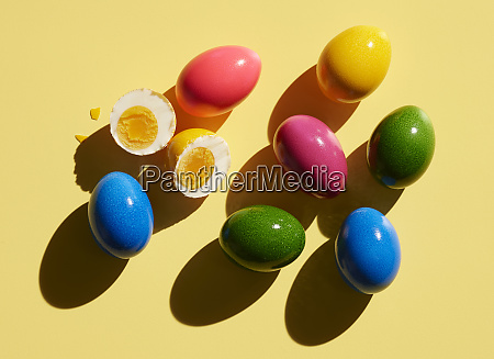 dyed easter eggs on yellow background