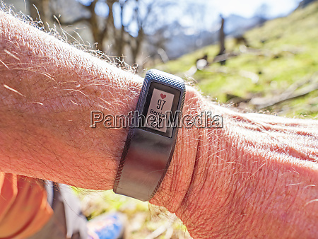 smartwatch with data on wrist of