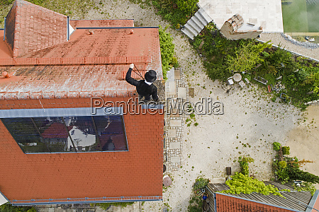 aerial view of chimney sweep working