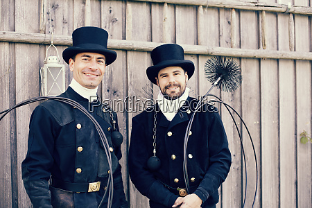portrait of two smiling chimney sweeps