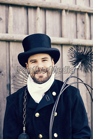 portrait of smiling chimney sweep