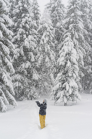 finland kuopio woman catching snowflakes in