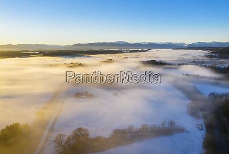 germany bavaria loisach sunrise over winter
