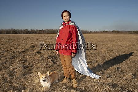 boy dressed up as superhero standing