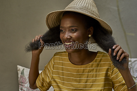 portrait of happy longhaired woman wearing