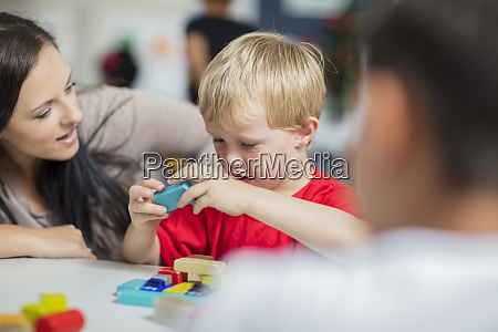 pre school teacher playing with child