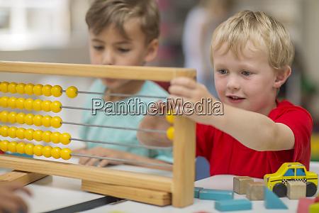 boys in kindergarten using abacus